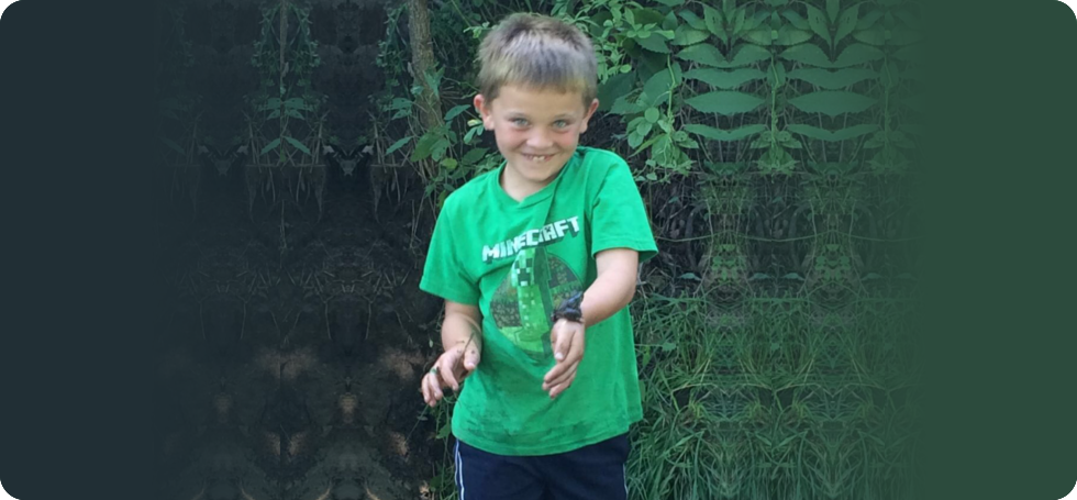 toddler holding a frog
